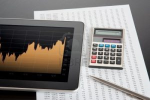 11849494-modern-stock-market-analyze-with-digital-tablet-calculator-pen-and-printed-data-sheet[1]