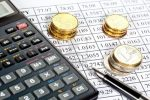 14041088-financial-analytics-euro-coins-calculator-and-a-pen-lying-on-a-currency-cross-rate-table[1]